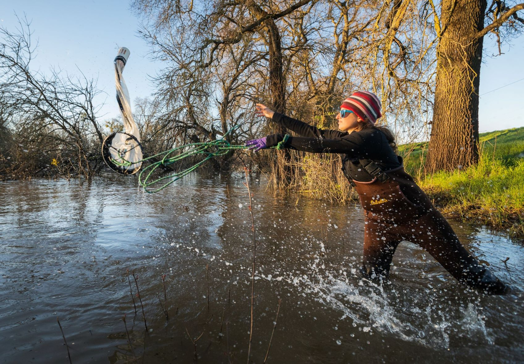 Person throwing net in river