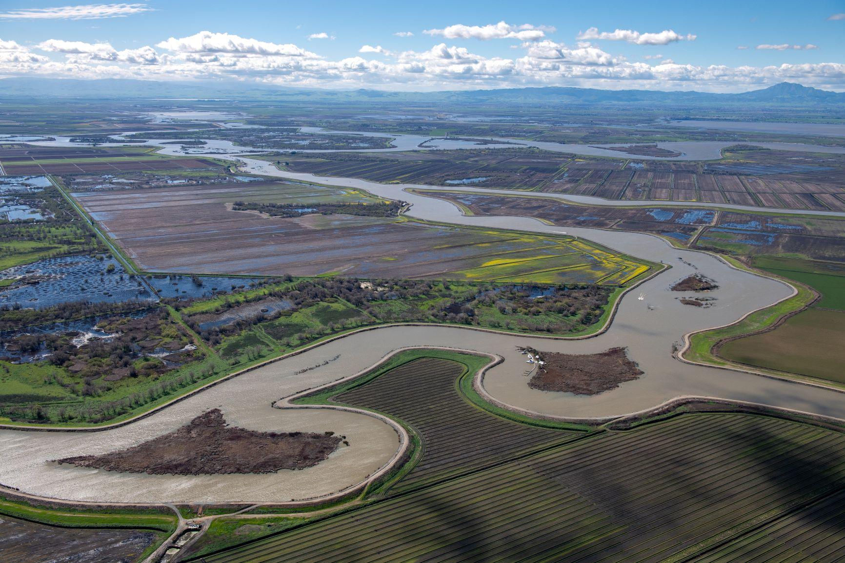 Aerial view of Sacramento-San Joaquin Delta waterways weaving through farmland