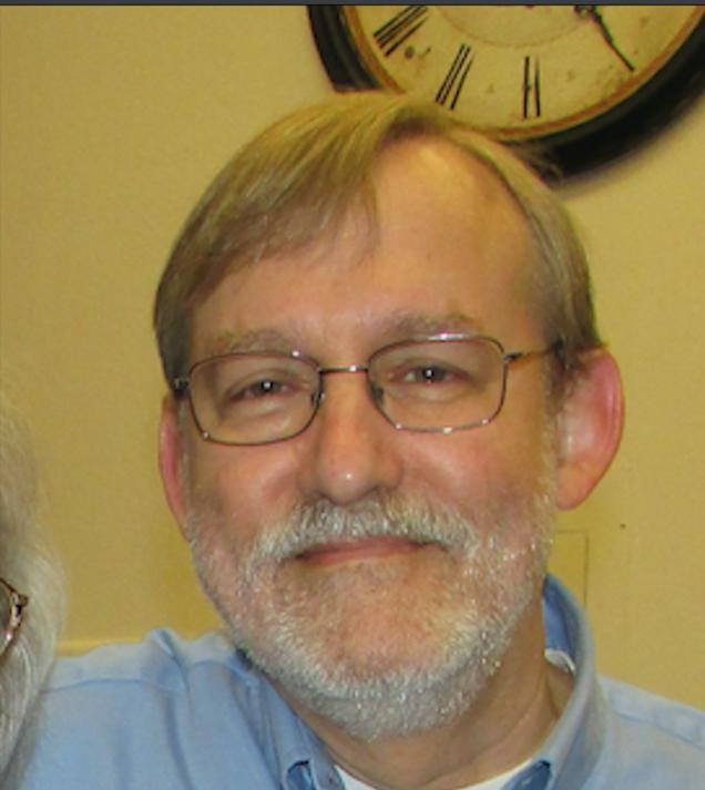Tim Stroshane wearing glasses with beard