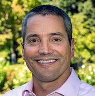 Secretary Wade Crowfoot headshot in front of greenery
